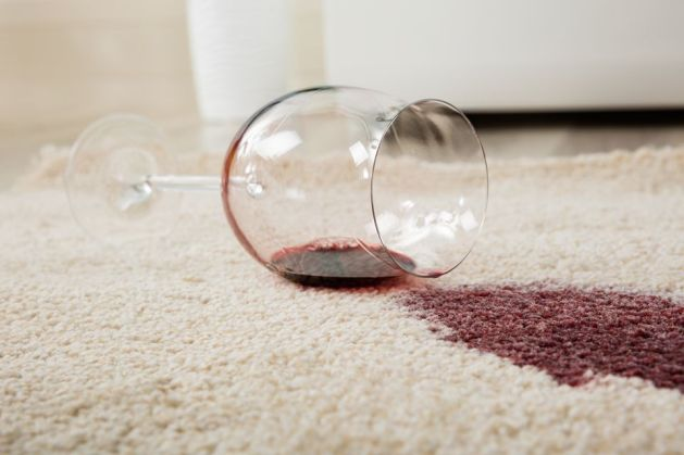 red-wine-spilled-from-glass-on-carpet
